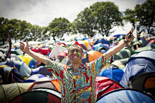 Happy festival go-er in the sunshine
