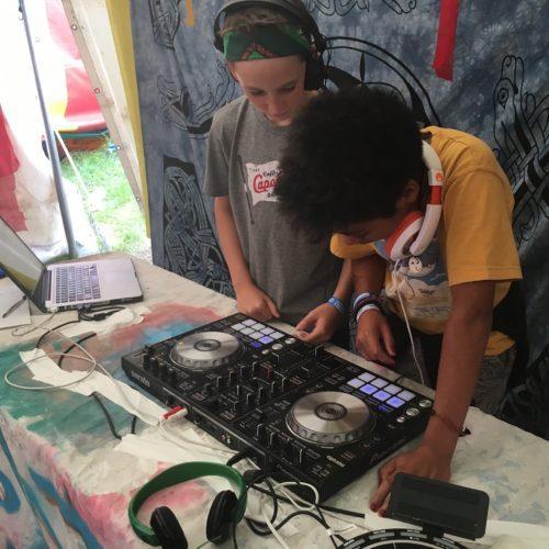 Kids mixing on the decks