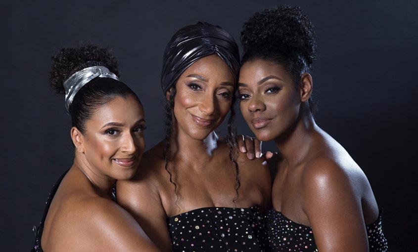 The three members of Sister Sledge smile