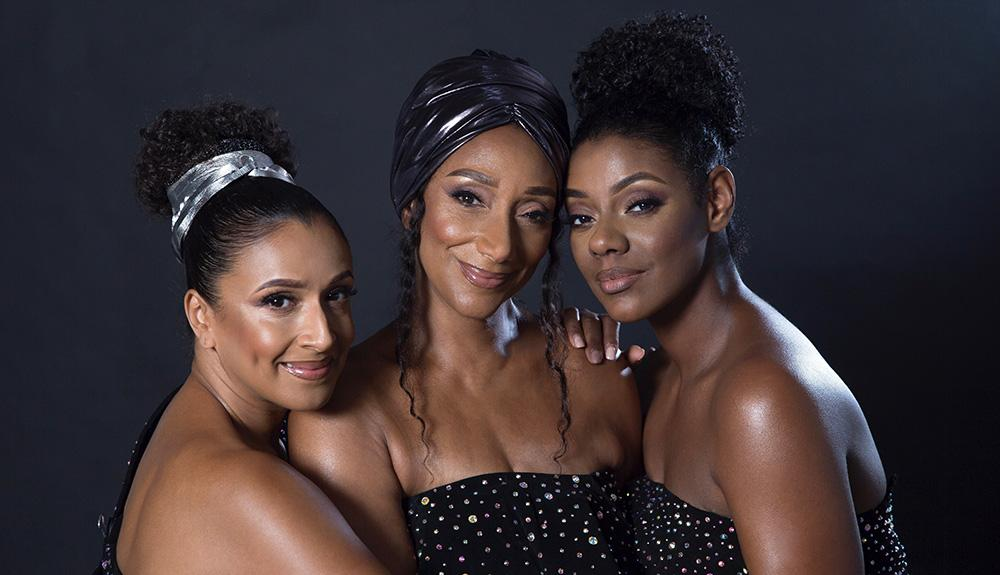 The three members of Sister Sledge smile