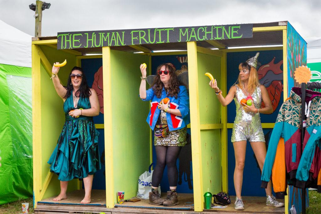 people playing human fruit machine