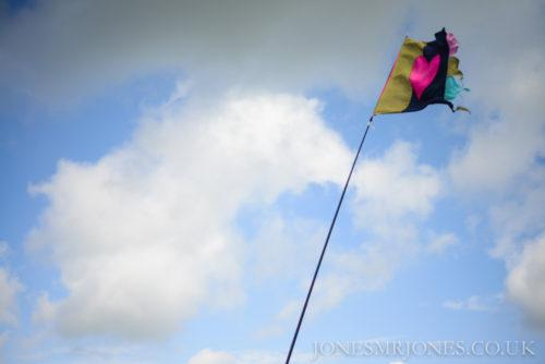 Flag waves in the sky