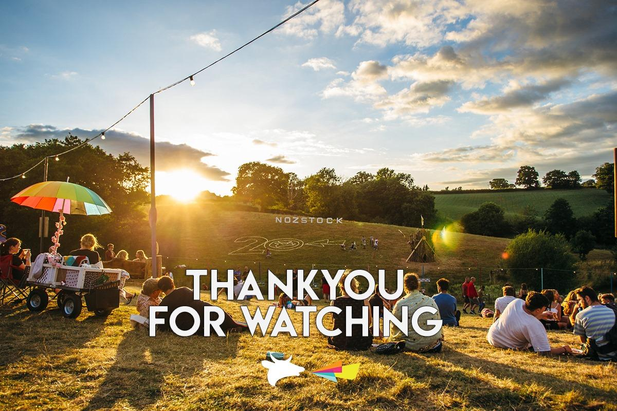 People gathered in a field at sunset - Thank you for watching